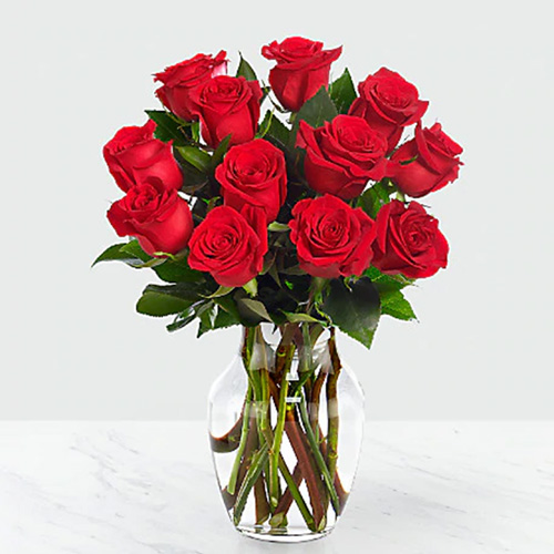 Dozen Red Roses in a Vase with Greens