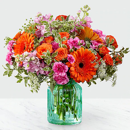 Orange and Pink Mixed Flowers in a Blue Vase