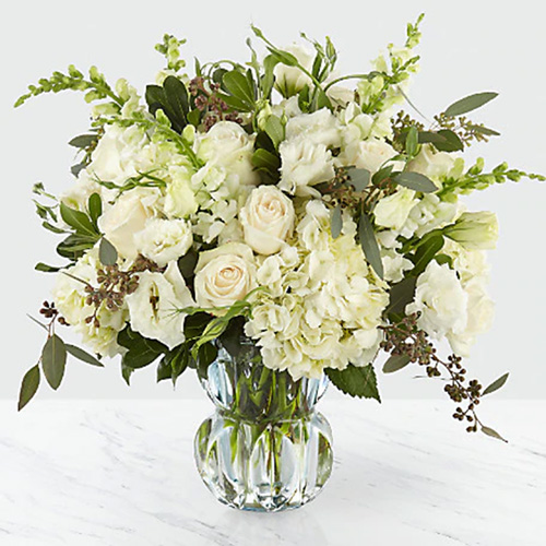 All White Assorted Flowers with Greens in a Vase